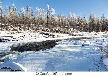 November landscape with unfrozen river in South Yakutia, Russia