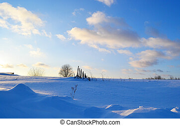 Winter landscape in the countryside at sunset