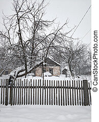 Winter landscape in the village. Street in the village in the snow after a snowfall