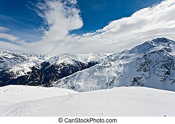 Winter landscape of a ski resort in the alps