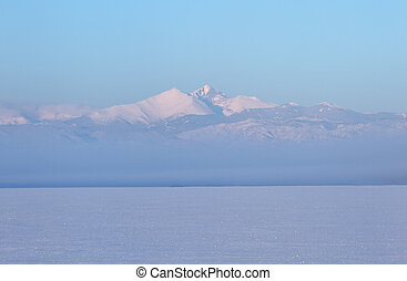 Winter Landscape of Longs Peak Mountain with snow and fog