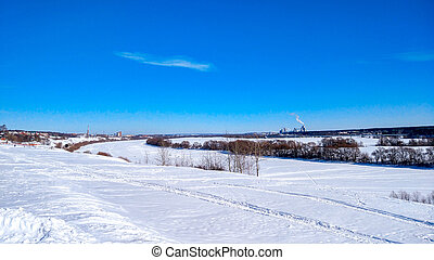 Winter landscape of the river. Beautiful lake background with trees and blue sky. Clear blue sky with clouds.