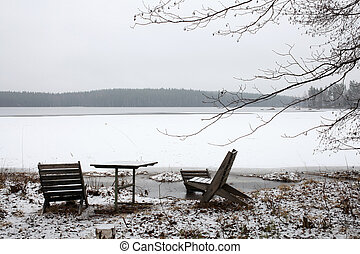 Winter landscape on a lake with table and chairs