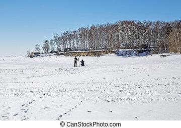 Winter landscape on the river. Siberia, Russia