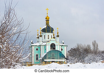 Winter landscape - Orthodox church in the snow among trees on a cold frosty day