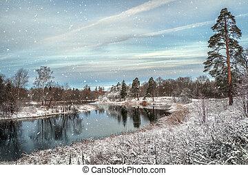 Winter landscape. Snowfall on the lake.