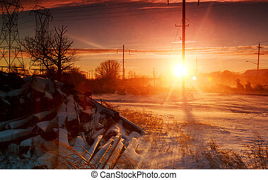 winter landscape, sunrise over farmhouse, on fenced field.