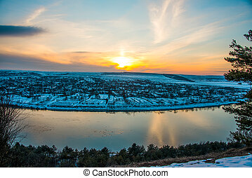 winter landscape sunset over the village