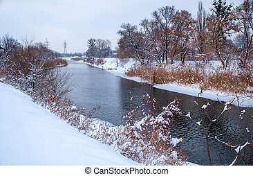 Winter landscape with a river.