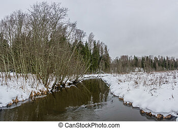 Winter landscape with a small river. - Beautiful winter...