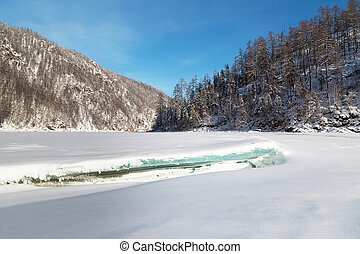 Winter landscape with ice floe in the foreground, South Yakutia, Russia