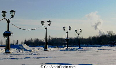 Winter landscape with lanterns and smoking factory pipes timelapse