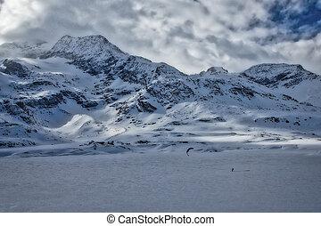 Winter landscape with ski kiting