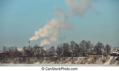Winter landscape with smokestack