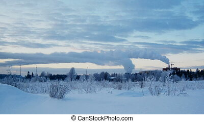 Winter landscape with smoking factory pipes timelapse -...