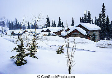 Winter Landscape with Snow Covered Roofs in the Alpine Village of Sun Peaks