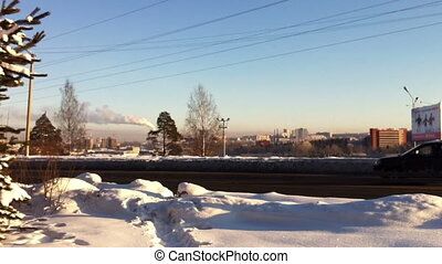 Winter landscape with traffic and smoking pipes timelapse -...