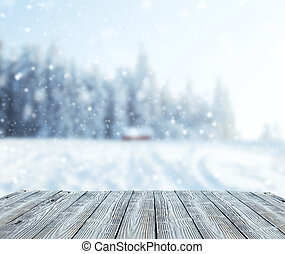 Winter landscape with wooden planks