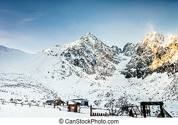 Winter lanscape with mountains full of snow. Beautiful landscape in the mountains on a sunny day skiing