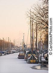 Winter light over frozen harbour