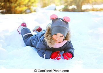 Winter little child playing having fun in snow
