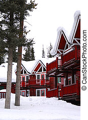 Winter lodge - Log buildings of a mountain lodge in winter...