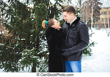Winter love story. Beautiful pair of lovers in the park