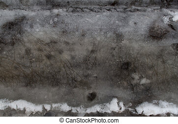 Winter melting snow dark gray background reflection in water