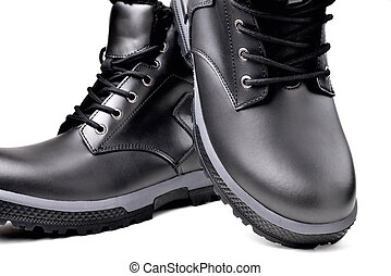 Winter men's black leather shoes on a white background, hiking shoes, practical off-road shoes, close-up details of the model, close-up