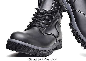 Winter men's black leather shoes on a white background, hiking shoes, practical off-road shoes, close-up details of the model, close-up i