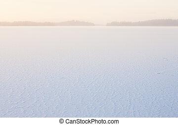 Winter morning view to frozen lake