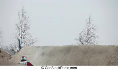 Winter motocross high jumping