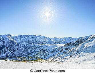 Winter mountain landscape against the blue sky. Peaks of...