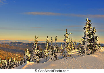 Winter mountain landscape at the gentle colors of setting sun