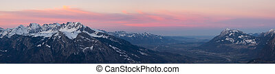 winter mountain landscape panorama at sunset