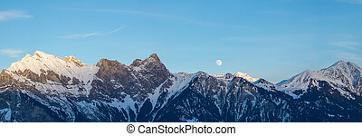 winter mountain landscape with a full moon