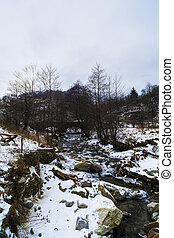 Winter mountain landscape with a river