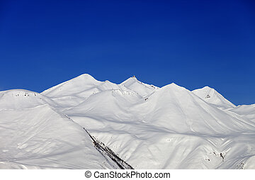 Winter mountains and blue sky