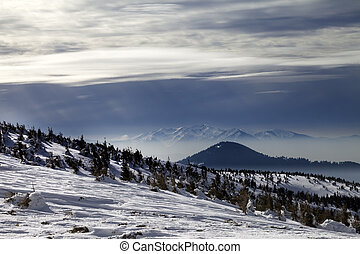Winter mountains and cloudy sky
