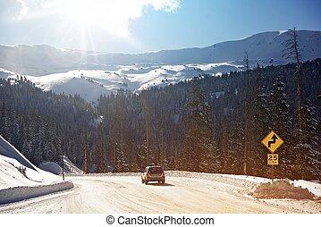 Winter Mountains Drive. Car on the Colorado Mountain Road.