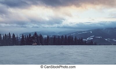Winter mountains in sunset time. Time lapse