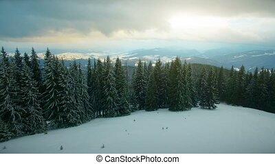 Winter mountains, sunset time. Ski resort - Flight over...