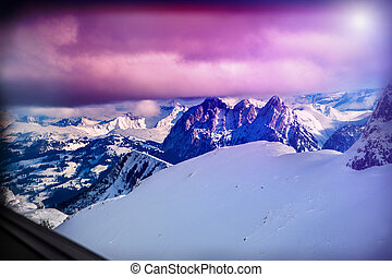Winter mountains Switzerland in sunshine. Mountainside and deep snow.