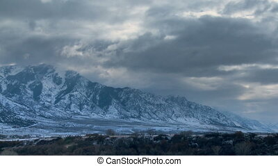 Winter Mountains Time-lapse - Fast moving clouds against a...