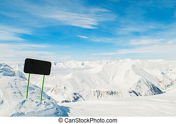 Winter mountains with blank sign
