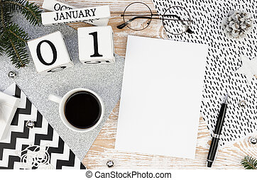 Winter New Year mockup. Flat lay Wooden calendar January 1st Cup of coffee, empty cover white magazine with space for text. Wooden planks background
