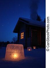 Winter night cabin