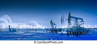 Winter night panoramic oil pumpjack. - Oil and gas industry....