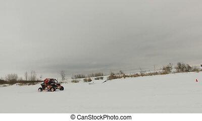 Winter off-road racing. Buggy race.