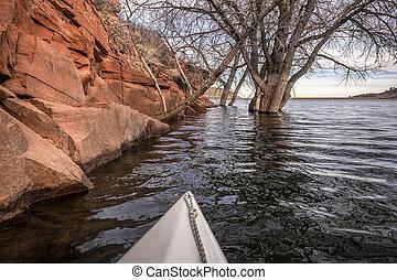 winter paddling on mountain lake in Colorado